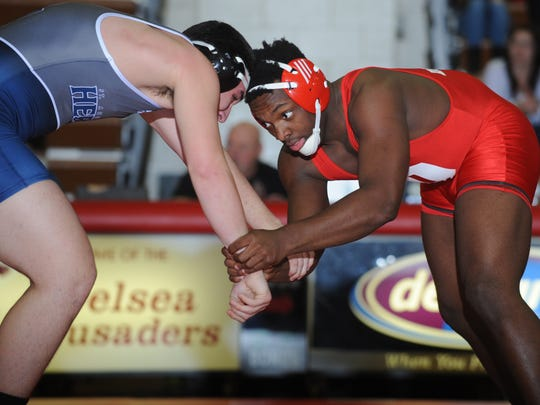 Delsea's Malcolm Henry, right, wrestles St. Augustine's Ryan Lynd earlier this season.