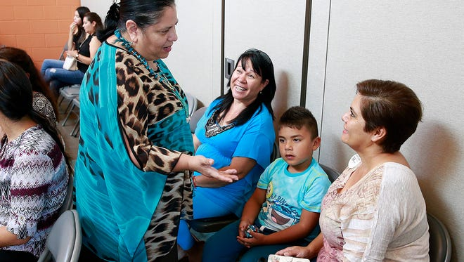 Consuelo Castillo Kickbusch, left, talks with Susana Jacquez, Esperanza Elementary first-grader Othoniel Oñate and his mother, Anneyde Soto, on Thursday during a meeting at the Sycamore Park Community Center.