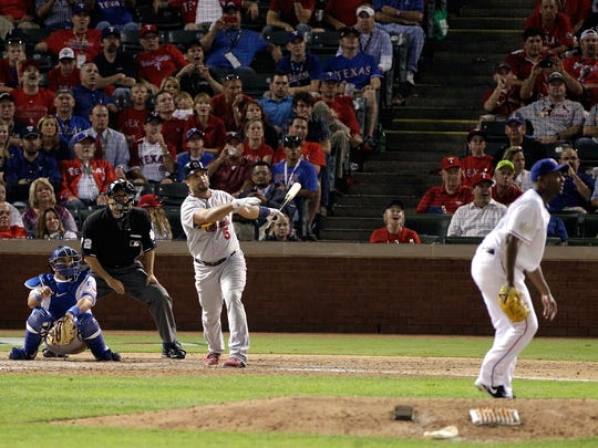 Albert Pujols of the St. Louis Cardinals hits a solo