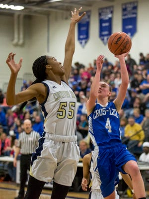 Croswell-Lexington's Sydney Soper goes for a shot and is blocked by Detroit Country Day's Tylar Bennett during a regional semifinal basketball game Tuesday, March 7, 2017 at Yale High School.