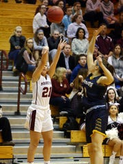 Morristown's Nicole Ferrara goes for a jump shot during a Morris County Tournament girls basketball semifinal against Jefferson at the County College of Morris. February 16, 2018. Randolph, NJ.