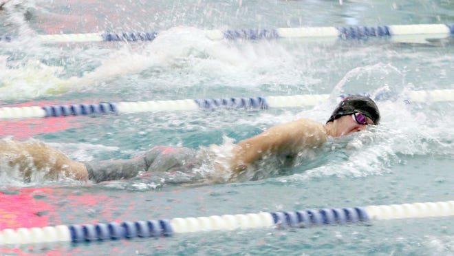 Kewanee's Emmitt Brokaw competes in Lane 3 in the third heat of the 100 freestyle on Tuesday at Five Points Washington.