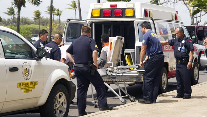 "A 16-year-old boy, seen sitting on a stretcher center, who stowed away in the wheel well of a flight from San Jose, Calif., to Maui is loaded into an ambulance at Kahului Airport in Kahului, Maui, Hawaii Sunday afternoon, April 20, 2014. The boy survived the trip halfway across the Pacific Ocean unharmed despite frigid temperatures at 38,000 feet and a lack of oxygen, FBI and airline officials said. FBI spokesman Tom Simon in Honolulu told The Associated Press that the boy was questioned by the FBI after being discovered on the tarmac at the Maui airport with no identification. ""Kid's lucky to be alive,"" Simon said."