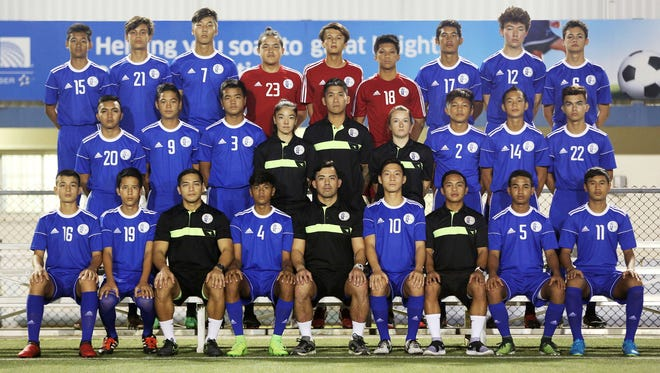 "A total of 23 players made the final cut for the Guam's U16 national team called up to compete in the upcoming AFC U16 Championship Qualification Round in Indonesia. Seated from left: Anthony ""Taiga"" Simon, Emilio Babauta, assistant coach Mark Chargualaf, co-captain Robert Niu, head coach Dominic Gadia, co-captain Kyle Halehale, assistant coach Bryan Cadiz, Tayler Bonner, and Micah Hennegan. Middle row from left: Shaun-Paul Martinez, Mark Iseke, Josiah Duenas, team manager Kimberly Sherman, goalkeeper coach Ross Awa, team trainer Alexis Gambrell, Kris Fernandez, Matthew Iseke, and Noah Mueller. Back row from left: Sho Meyar, Morgan McKenna, James Lee, goalkeepers Allan Aranas, Alexander Stenson, and Marcus Del Rosario, Juan Sarmiento, Shane Larkin, and Hayden Shedd. Joshua Bamba and Graysen Garber, not pictured, are also on the team."
