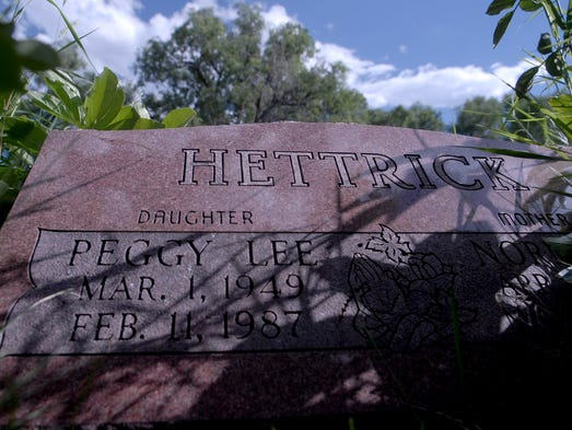 The tombstone of Peggy Hettrick in Loveland is overgrown