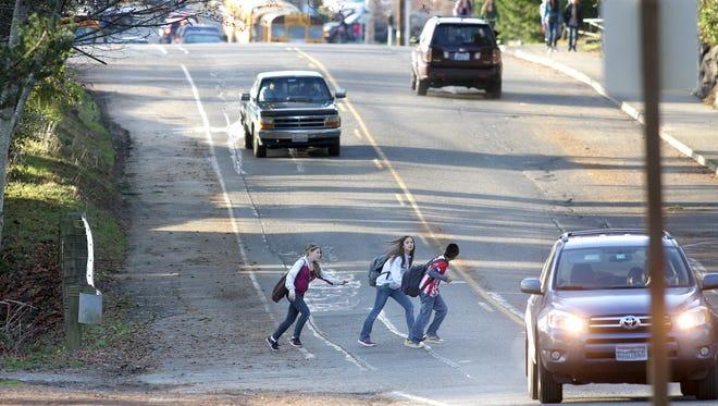 2010 FILE PHOTO Poulsbo Junior High School students cross Hostmark after School on Friday. LARRY STEAGALL  |  KITSAP SUN