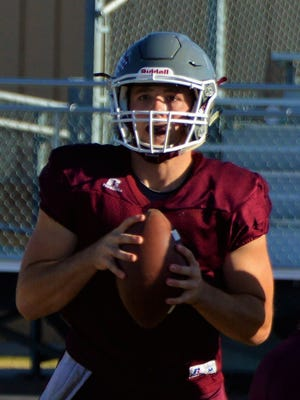Hawley senior quarterback Quay Stokes looks for a receiver during practice on Nov., 1, 2017 in Hawley.