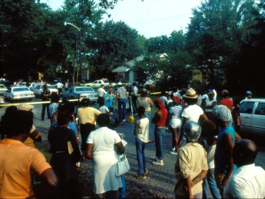 A crowd gathers on the Cedar Grove street where four bodies were found July 19, 1985. Nathaniel Code was tried for the homicides of Vivian Culbert Chaney, Carlitha Culbert, Jerry Culbert and Billy Joe Harris, and was given the death penalty in 1990. However, he remains on Louisiana's death row.