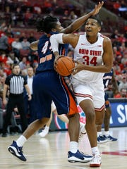 Ohio State's Kaleb Wesson, right, turns to shoot over Morgan State's Jamar Brown during the second half of an NCAA college basketball game Friday, Nov. 29, 2019, in Columbus, Ohio. Ohio State beat Morgan State 90-57. (AP Photo/Jay LaPrete)
