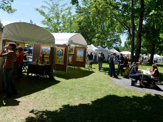 Participants browse the various vendor tents at Art