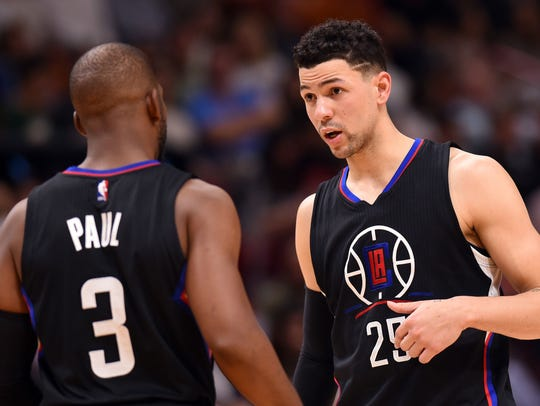 Austin Rivers listens to Chris Paul during the second