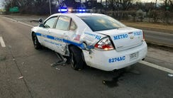 A Metro police officer was hit while sitting in his