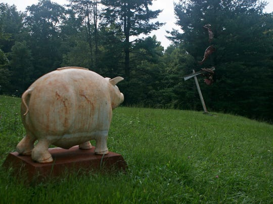 """""""Saved,"""" a pig made from iron by artist Joe McCreary, weighs 700 pounds and can be found at Sculpture Trails Outdoor Museum."""