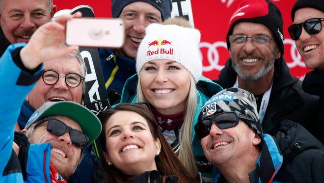 United States' Lindsey Vonn celebrates with her team after winning an alpine ski, women's world Cup downhill race, in Garmisch Partenkirchen, Germany, Sunday, Feb. 4, 2018.