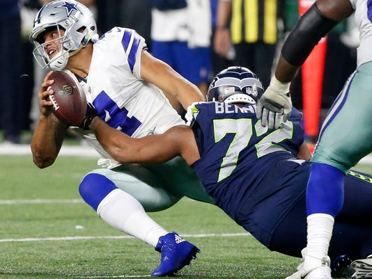 Dallas Cowboys quarterback Dak Prescott (4) is sacked by Seattle Seahawks' Michael Bennett (72) late in the second half of an NFL football game, Sunday, Dec. 24, 2017, in Arlington, Texas. (AP Photo/Michael Ainsworth)