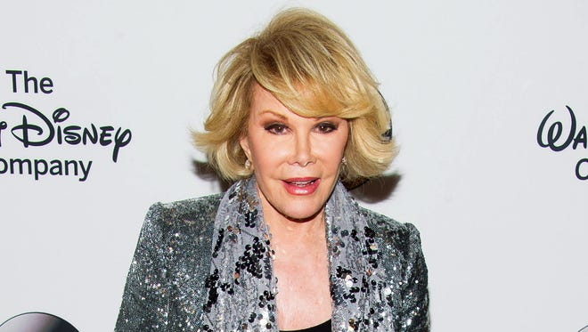 In this May 14, 2014 file photo, TV personality Joan Rivers attends A Celebration of Barbara Walters in New York. Melissa Rivers announced Thursday, Sept. 4, that her mother Joan died Thursday, in New York. Rivers was hospitalized Aug. 28, after going into cardiac arrest at a doctor's office.