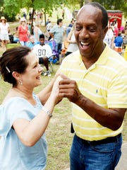 Charles Riser and Phyllis Castille dance to music during