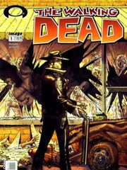 "Cover of ""The Walking Dead"" comic book by Robert Kirkman and Aurora, Ind., resident Tony Moore."