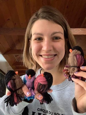 Craft Lovers group leader Raina Bowers showing her yarn birds made during a virtual Craft Lovers tutorial.