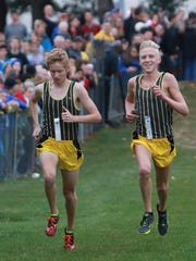 Watkins Memorial's Daniel White, left, and Andrew Jordan near the finish line this past Saturday during the Division I, Section 2 race. Jordan and White took the top two spots.
