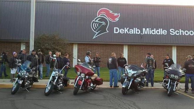 Members of United Motorcycle Enthusiasts line up outside DeKalb Middle School.
