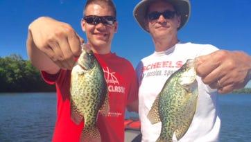 Geralyn and Greg Miller behind a nice Hayward area walleye.