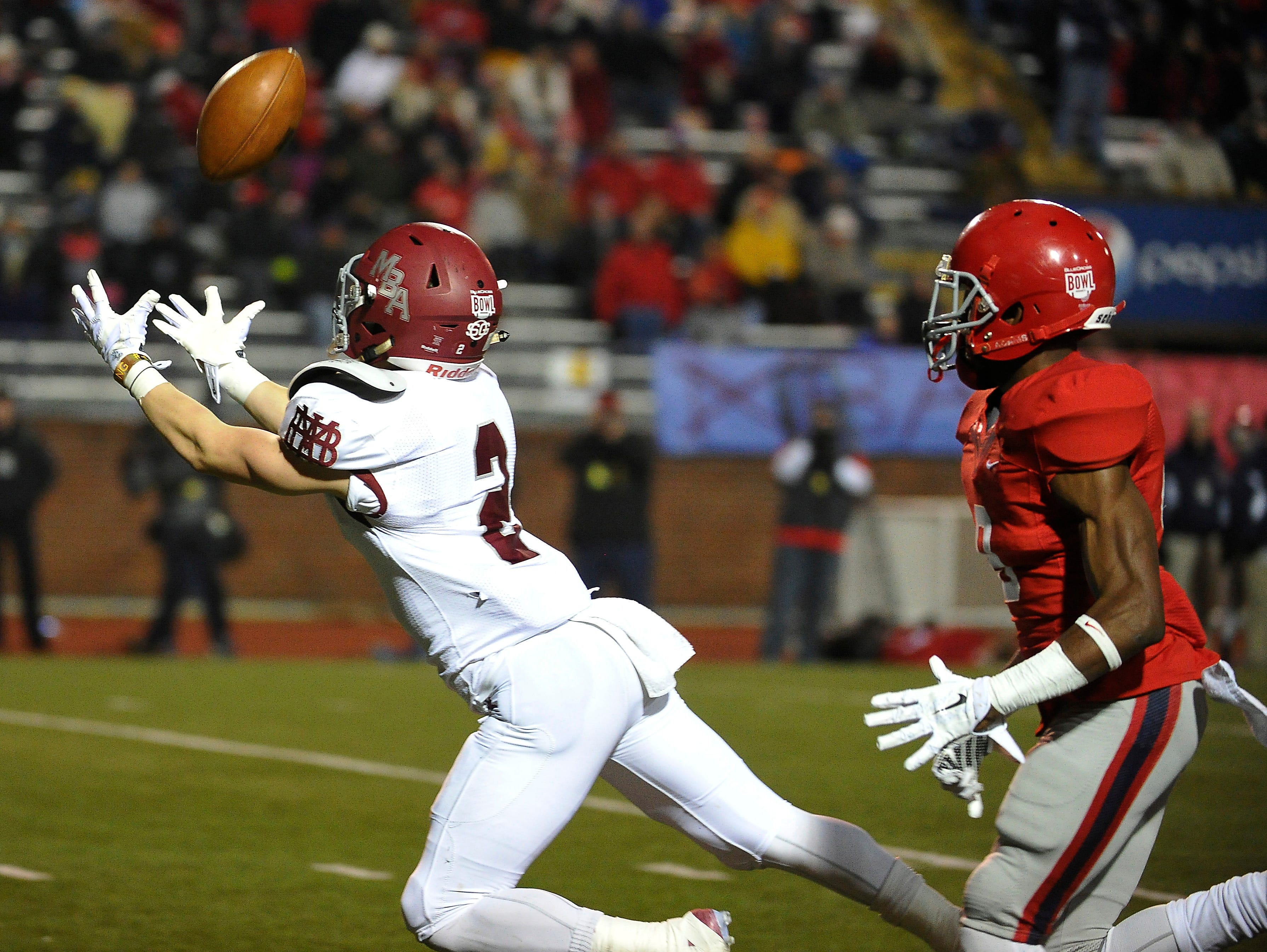 Montgomery Bell Academy's Montgomery Owen brings in a pass against Brentwood Academy in the BlueCross Bowl DII-AA state title game on Dec. 3, 2015, in Cookeville.