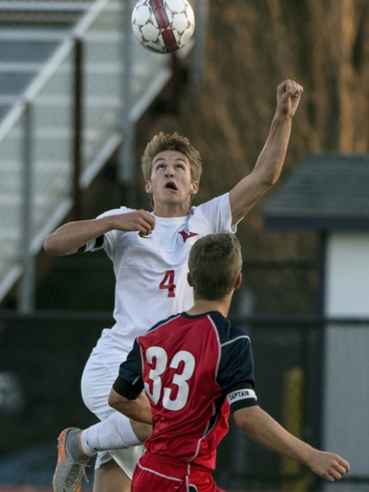 Annville-Cleona captain Matt Light goes up for the ball against Conestoga Valley's Connor Whitacre during the Buckskins' 4-0 win in an L-L tournament semifinal Tuesday at Manheim Township.