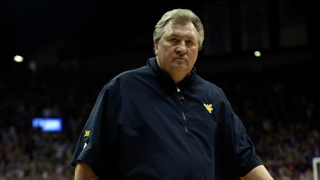 West Virginia head coach Bob Huggins leaves the floor after being ejected during the second half of an NCAA college basketball game against Kansas in Lawrence, Kan., Saturday, Feb. 17, 2018. Kansas defeated West Virginia 77-69. (AP Photo/Orlin Wagner) ORG XMIT: OTKOW