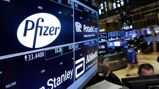 In this Oct. 29, 2015, file photo, the logo for Pfizer is displayed on a trading post on the floor of the New York Stock Exchange.