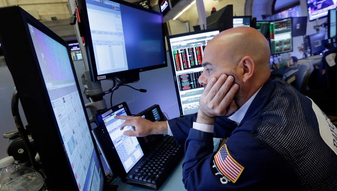 Trader Fred DeMarco works on the floor of the New York Stock Exchange, Friday, June 24, 2016. U.S. stocks are plunging in early trading after Britons voted to leave the European Union.