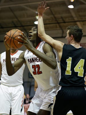Park Tudor Panthers Jaren Jackson Jr. (32) is fouled as he shoots by Lapel Bulldogs JonRoss Richardson (14) in the first half of their game Tuesday, Feb 23, 2016, evening at Park Tudor High School.