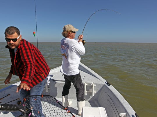 When Capt. Noe hooked a big redfish, the roles became reversed and Jonathan Fernandez quickly reached for the net.
