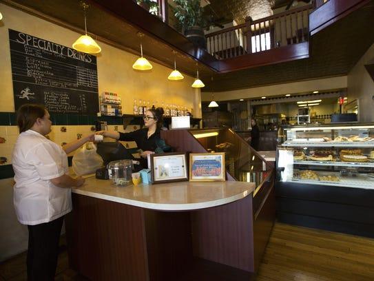 Si Italian Bistro employee Katie Hixon hands a customer