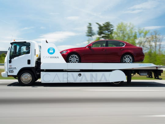 A vehicle is delivered on one of Carvana's trucks.