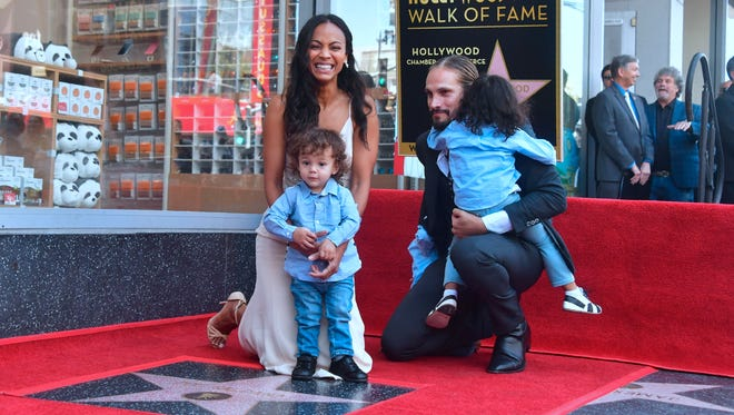 What cuties! Zoe Saldana poses with her husband and children at her Hollywood Walk of Fame Star ceremony.