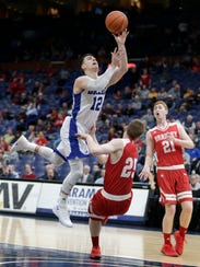 Drake's Reed Timmer (12) shoots as he is fouled by