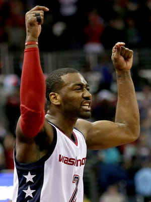 Washington Wizards guard John Wall (2) celebrates after defeating the Boston Celtics in game six of the second round of the 2017 NBA Playoffs at Verizon Center.