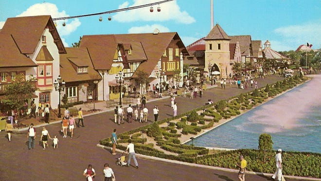 This undated postcard shows Kings Island's International Street and fountains, surrounded by manicured shrubs and landscaping.