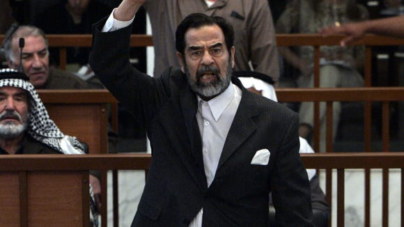Former Iraqi dictator Saddam Hussein during his trial