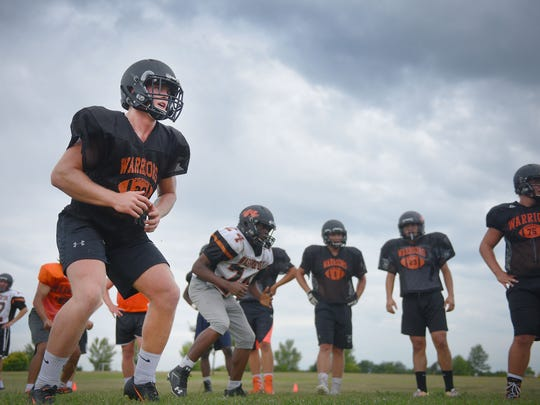 Washington High School kicker Brock Walker  leads his section during conditioning at  practice Saturday, Aug. 12, at the high school in Sioux Falls.