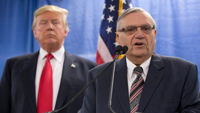 Republican presidential candidate Donald Trump, left, is joined by Maricopa County, Ariz., Sheriff Joe Arpaio during a news conference at the Roundhouse Gymnasium, Tuesday, Jan. 26, in Marshalltown, Iowa.