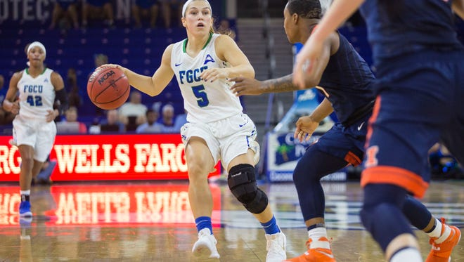 Eagles guard Lisa Zderadicka maneuvers the ball down the court at Alico Arena where the FGCU women's basketball team faced Illinois on Sunday, Nov. 12, 2017.