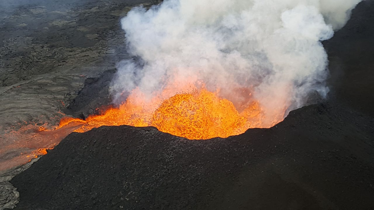Video from Hawaii's Big Island shows a fast-moving river of lava from Kilauea volcano's Fissure 8 moving quickly at night. Hawaii National Guard soldiers escorted media to a location where they could see the lava. (June 21)