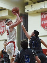Red Hook High School's Colin Bemis takes a shot against