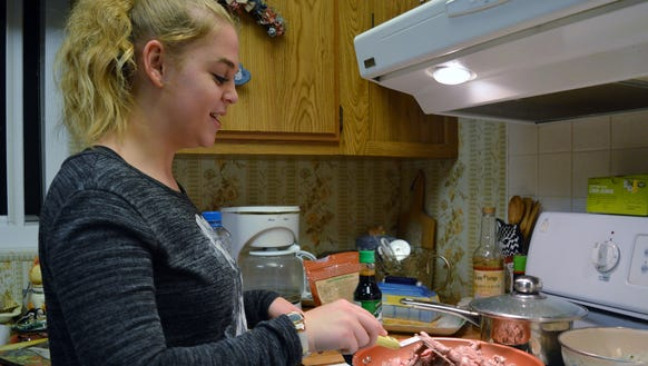 Rylee Jerman browns slices of Angus beef for a diabetic-friendly
