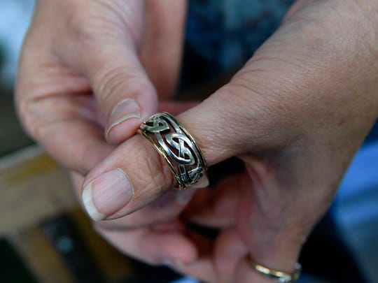 Lanora Davidson holds one of the Irish rings she sells at her Dublin store, Things Celtic. The store opened June 1.