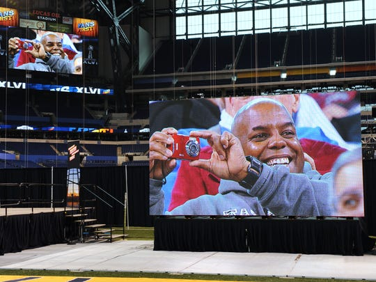 A man takes a photo of himself  on the big screen at Lucas Oil in 2012.