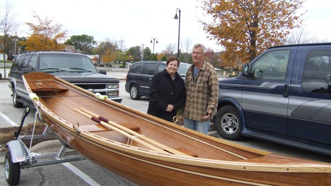 The Rev. Patricia McClelland, Rockford, Ill., was thrilled upon receiving word of winning the grand prize in this year's Door County Maritime Museum boat raffle. The prize was drawn Sunday, Oct. 12, at the Pumpkin Patch Festival in Egg Harbor.  McClelland is posing with volunteer instructor Jerry McNamara. The summer-long raffle included more than 60 prizes but the hand-crafted, classic wooden boat constructed by the museum's boatbuilding class remained the featured prize.