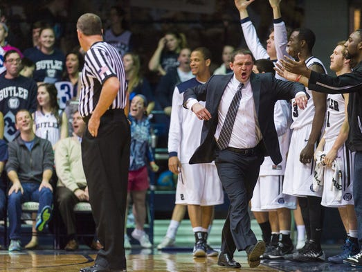 Butler University head coach, Brandon Miller, reacts to a Butler player being called for a foul during the first half of men's basketball action Thursday, Feb. 13, 2014, at Butler University's Hinkle Fieldhouse.